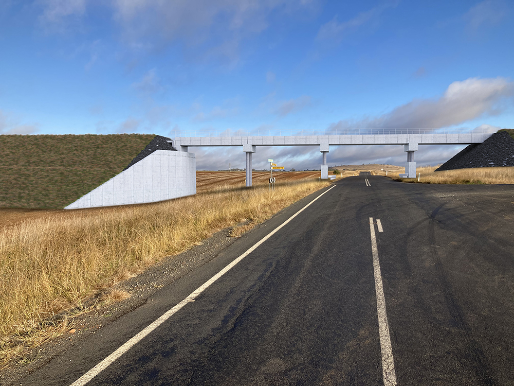 The reference design proposes constructing a rail bridge over Old Cootamundra Road, Dudauman