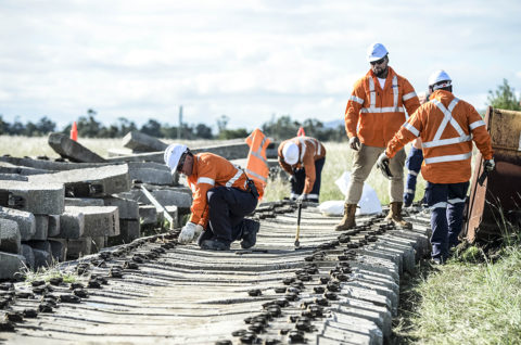 Construction workers laying track